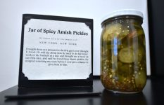 A 'Jar of Spicy Amish Pickles' is among one of the many items and writings on display The Museum of Broken Relationships in Hollywood, California on December 9, 2016 where memories of broken hearts live.  / AFP / Frederic J. BROWN        (Photo credit should read FREDERIC J. BROWN/AFP/Getty Images)