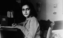 Anne Frank at her desk in Amsterdam.